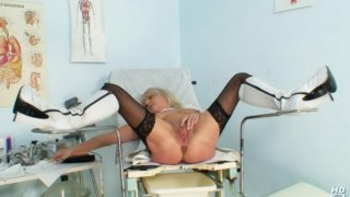 Grandma in uniform spreads blond shaggy piss hole
